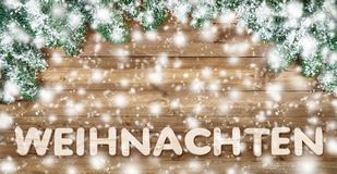German word for Christmas, with wood and snow royalty free stock images