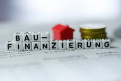 German Word Construction Financing formed by alphabet blocks: BAUFINANZIERUNG. Real estate business Royalty Free Stock Photos