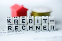 German Word CREDIT CALCULATOR formed by alphabet blocks: Kreditrechner. Real estate business Stock Photography