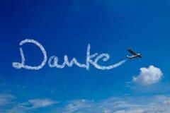 German word Danke in sky. Airplane painting the German word Danke (Thanks) in the sky Stock Photo