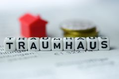 German Word DREAMHOUSE formed by alphabet blocks: TRAUMHAUS. Real estate business Stock Photo