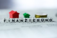 German Word FINANCING formed by alphabet blocks: FINANZIERUNG. Real estate business Stock Photo