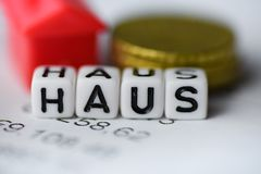 German Word HOUSE formed by alphabet blocks: HAUS. Real estate business Stock Image