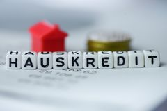 German Word HOUSE LOAN formed by alphabet blocks: HAUSKREDIT. Real estate business Stock Photos