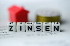 German Word INTEREST formed by alphabet blocks: ZINSEN. Real estate business Stock Photography