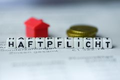 German Word LIABILITY formed by alphabet blocks: HAFTPFLICHT. Real estate business Royalty Free Stock Photo