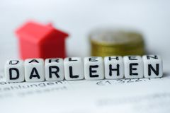 German Word LOAN formed by alphabet blocks: Darlehen. Real estate business Royalty Free Stock Photography