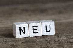 German word new, written in cubes Stock Image