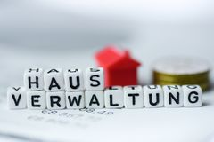 German Word Property management formed by alphabet blocks: HAUSVERWALTUNG. Real estate business Royalty Free Stock Photo