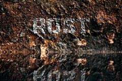 German word for Rust on rusty background Stock Photography