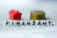 German Word TAX Office formed by alphabet blocks: FINANZAMT. Real estate business Stock Photos