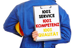 German worker with slogan on clipboard Stock Photo