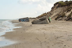 German World War II bunkers sinking into the sand, Skiveren beach, Denmark Stock Photo