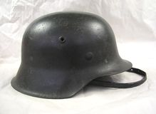 German World War 2 WWII Military Helmet with chin strap. German World War 2 WWII Military Soldier Helmet with chin strap stock photo