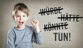 German Would, could, should, do, Boy on grunge background writin Royalty Free Stock Photo