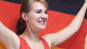 German Young Woman Celebrates holding the Flag of Germany in Slow Motion. 4k , high quality stock video