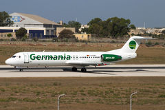 Germania Fokker 100. Luqa, Malta August 13, 2004: Germania Fokker 100 (F-28-0100) [D-AGPM] exiting onto the runway from Taxiway C Stock Photos