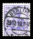 Germania with imperial crown, inscription 'REICHSPOST', serie, circa 1900. MOSCOW, RUSSIA - FEBRUARY 10, 2019: A stamp printed in German Realm shows Germania royalty free stock photography