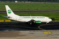 Germania passenger aircraft Boeing 737-75B. Rolls to the start at the airport of Duesseldorf (DUS). The aircraft has the identification D-AGEO Royalty Free Stock Photo
