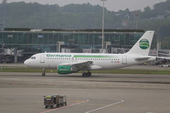 Germania plane on tarmac at Zurich Airport. ZURICH, SWITZERLAND - MAY 8, 2017: Germania plane on tarmac at Zurich Airport. Germania is a privately owned German Stock Photography