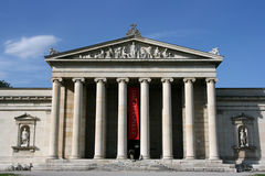 Germany. Glyptothek - museum in Munich, Germany. Old landmark. Text on the red flag is not copyrighted, means Theater plays Royalty Free Stock Images