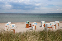 Germany, Baltic Sea, beach chairs at beach Stock Photography