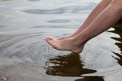 Germany, Baltic Sea, woman, feet in the water Stock Image