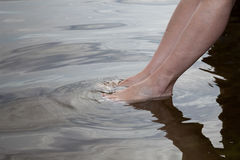 Germany, Baltic Sea, woman, feet in the water Stock Images