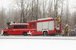 Germany, Bavaria; fire brigade at work under snowfall Royalty Free Stock Photos