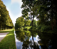 Germany,  Bavaria, park flanked by a channel with still waters Royalty Free Stock Images