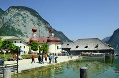 Germany, Bavaria. St. Bartolomew, Germany - June 12, 2015: Unidentified tourist on sightseeing of the little church on Koenigssee lake, preferred tourist Stock Photography