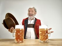 Germany, Bavaria, Upper Bavaria, man with beer dressed in traditional Austrian or Bavarian costume. Germany, Bavaria, Upper Bavaria. The senior happy smiling man stock photography