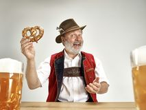 Germany, Bavaria, Upper Bavaria, man with beer dressed in traditional Austrian or Bavarian costume. Germany, Bavaria, Upper Bavaria. The senior happy smiling man stock image