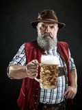 Germany, Bavaria, Upper Bavaria, man with beer dressed in in traditional Austrian or Bavarian costume. Germany, Bavaria, Upper Bavaria. The smiling man with beer royalty free stock images
