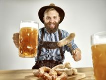 Germany, Bavaria, Upper Bavaria, man with beer dressed in traditional Austrian or Bavarian costume stock photography