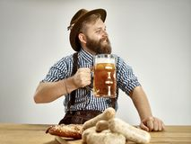 Germany, Bavaria, Upper Bavaria, man with beer dressed in traditional Austrian or Bavarian costume stock photo