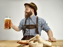 Germany, Bavaria, Upper Bavaria, man with beer dressed in traditional Austrian or Bavarian costume stock images