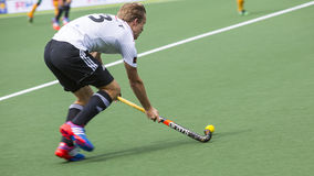 Germany beats South Africa during the Hockey World Cup 2014. THE HAGUE, NETHERLANDS - JUNE 1: German player is playing the ball during the Hockey World Cup 2014 stock photo