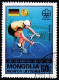 Germany bicycle rider Gregor Braun, from series `Olympic Games, Montreal - Gold Medal Winners`, circa 1976. MOSCOW, RUSSIA - APRIL 2, 2017: A post stamp printed Stock Photography