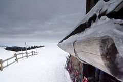 Timber gutter mountain lodge stock image