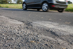 Germany, car on road, apshalt, pothole Stock Photos