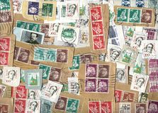 Horizontal background of German postage stamps. GERMANY - circa 1960-2005: Horizontal background of German definitive postage stamps on paper Royalty Free Stock Photo