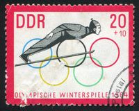 Ski Jump and Olympic Rings. GERMANY - CIRCA 1963: stamp printed by Germany, shows Ski Jump and Olympic Rings, circa 1963 Royalty Free Stock Image