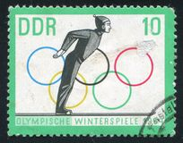 Ski Jump Start and Olympic Rings. GERMANY - CIRCA 1963: stamp printed by Germany, shows Ski Jump Start and Olympic Rings, circa 1963 Stock Photo
