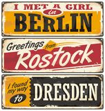 Germany cities and travel destinations. Retro metal plates set on old damaged background. Travel theme vector illustration
