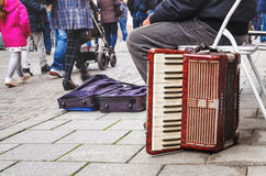 Germany, the city of Lahr 28 October 2015, accordion brand Hohne. R Tango IIB, Old accordion poor musician at passers-by of people background Royalty Free Stock Photography