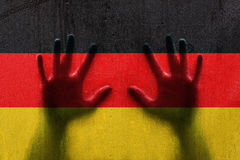 Germany droplet flag with person hands Stock Images