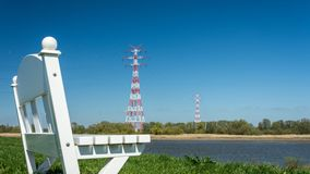Germany Elbe Landscape - Bench In Foreground. And Electricity Pole In Background Stock Photography