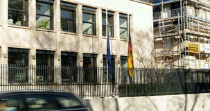 Germany embassy flag half-mast to pay tribute. STRASBOURG, FRANCE - NOV 14, 2015: Germany embassy flag half-mast to pay tribute to the victims of the attacks in stock video footage