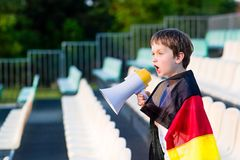Germany fan screaming through megaphone on the stadium Stock Images